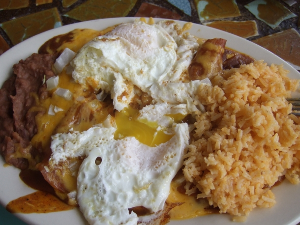 Enchiladas con huevos y cebollas at Spanish Village