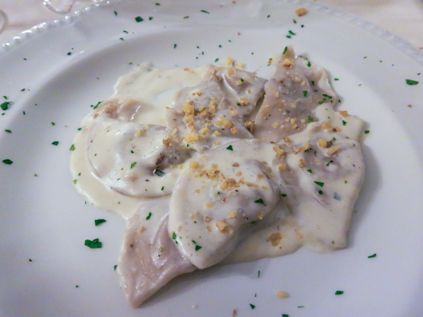 Agnolotti in a formadi frant cheese sauce